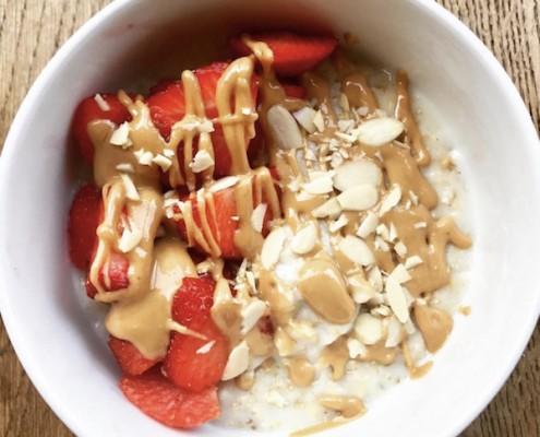 healthy-breakfast-porridge-strawberries-almonds-peanutbutter.jpg